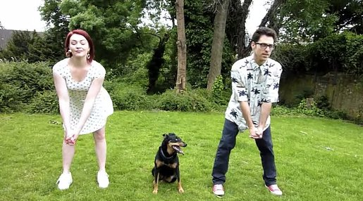 A Wimbledon Wiggle with a dog, a man and a woman